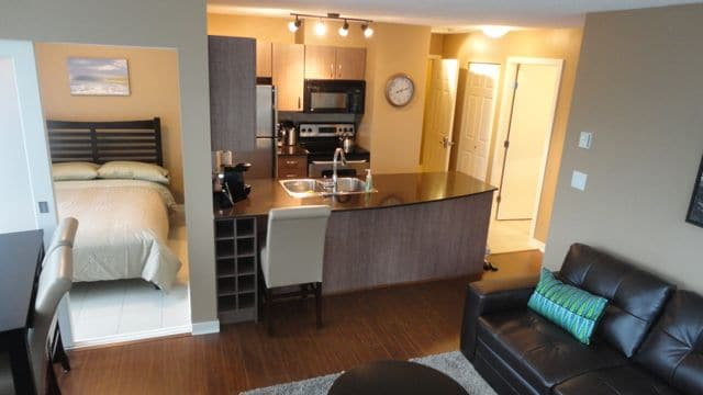 Den with Double bed and Stainless Steel Kitchen with granite counter Tops