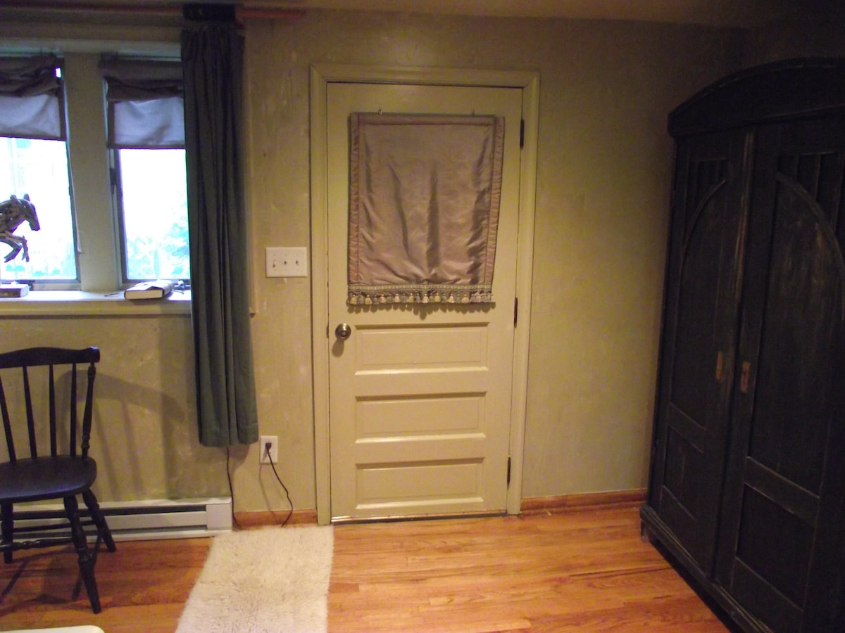 The door you just came through as you entered the cottage.