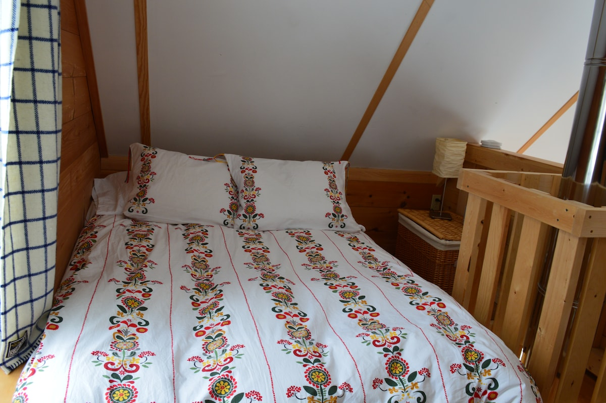 View of double bed in loft