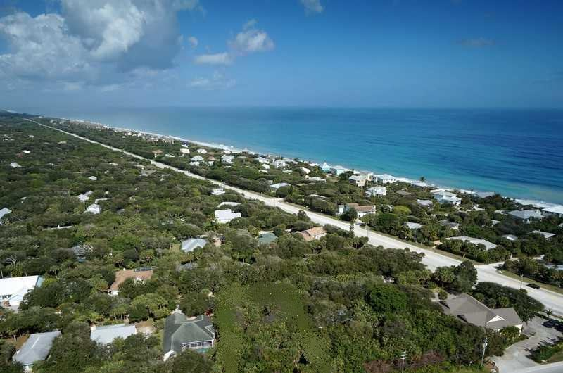 Aerial view of our community, Summerplace.  The main road (A1A) is a 45MPH, 2-lane road with a center turning lane (3 lanes total).  Our house is on the west side of A1A, bordering A1A, one block from the beach.