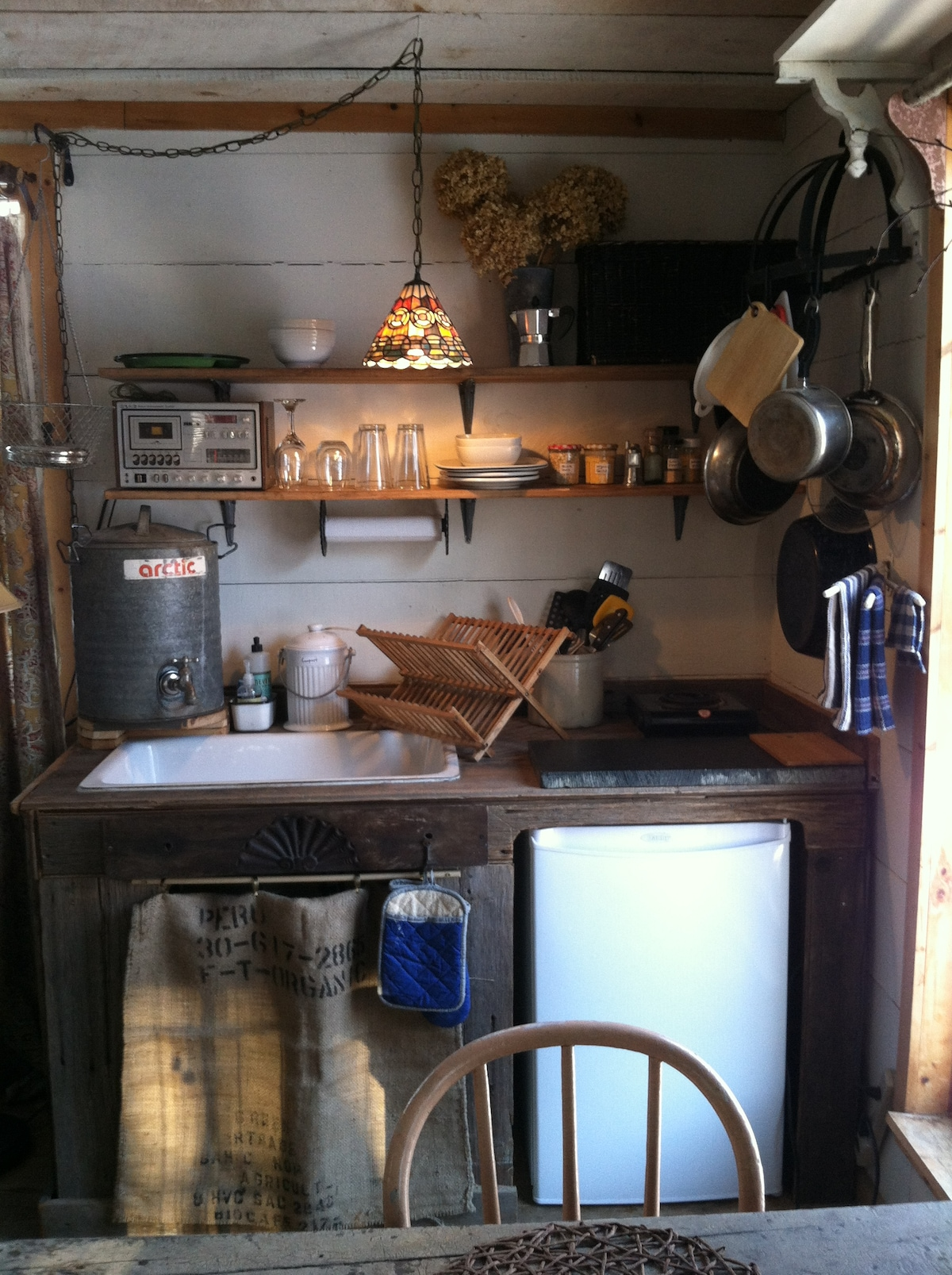 A brand new feature in the rustic cabin! a working, off grid type sink area, with lovely barn wood...enjoy the functional simplicity!