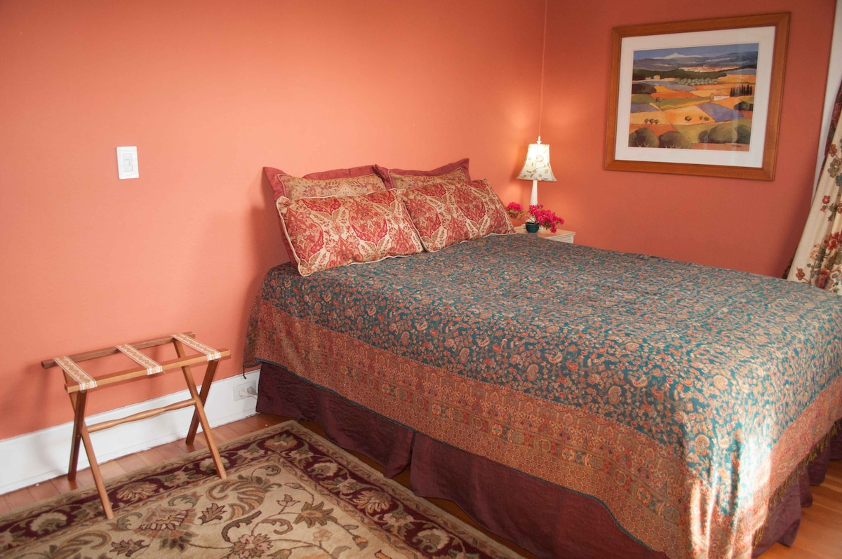 Luxurious linens and snuggly down comforter on the queen size bed  and room darkening curtains!