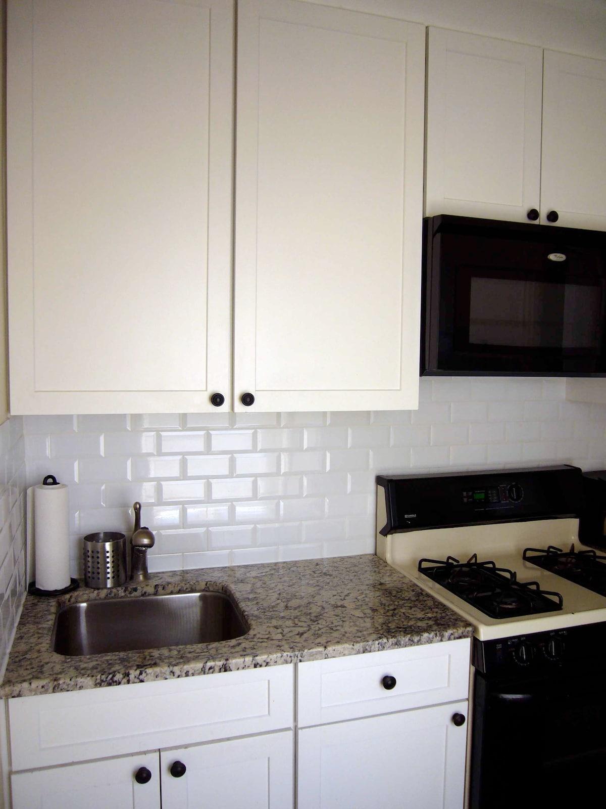 Granite counter top and subway backsplash