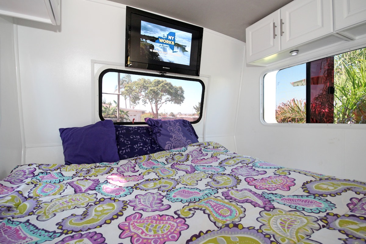 Queensize bed, new mattress and sliding door for privacy