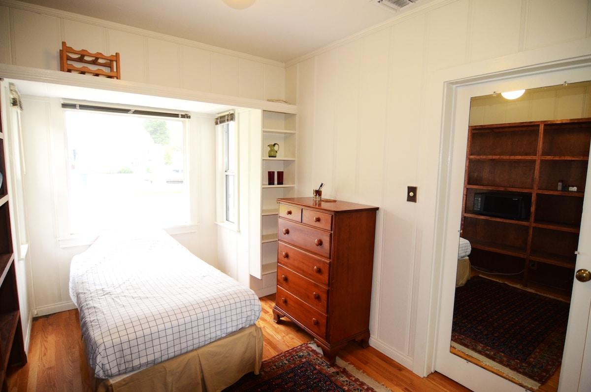 Bedroom # 1 with three windows and hardwood floors