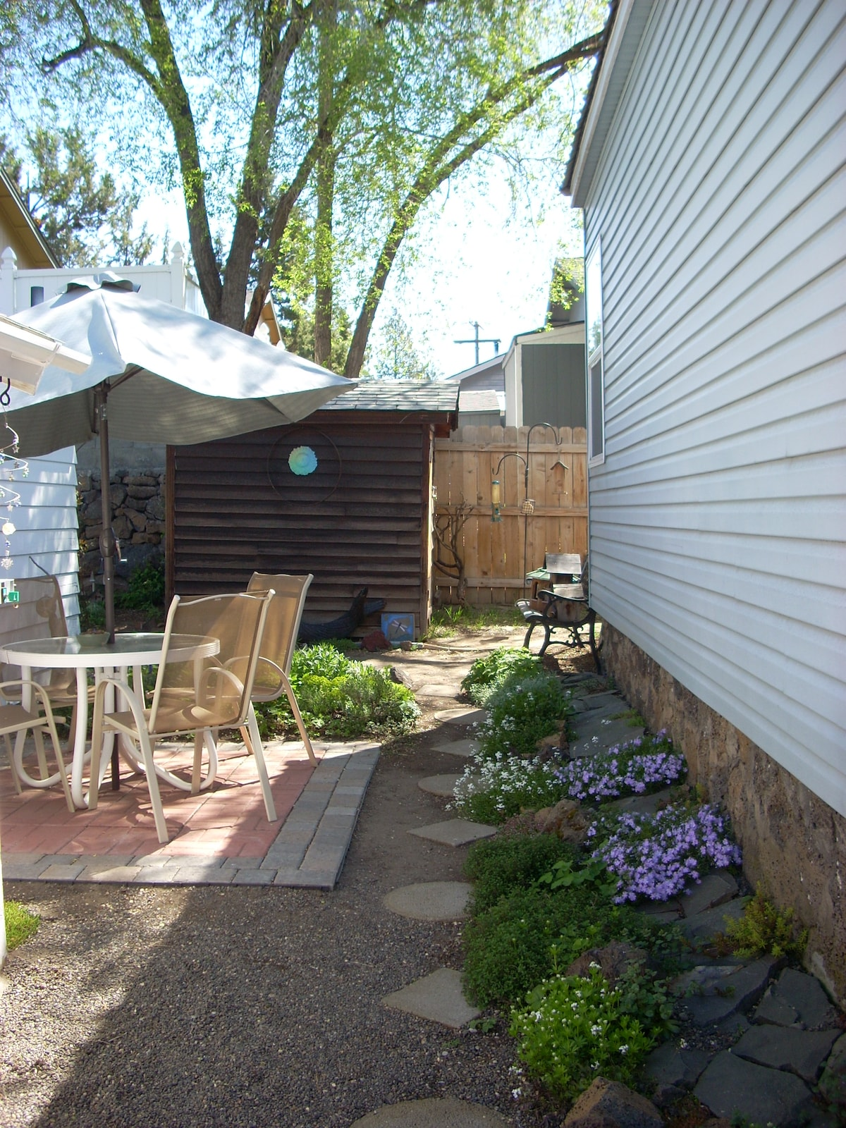 Your courtyard & patio, with private entrance to the Little House to the left.