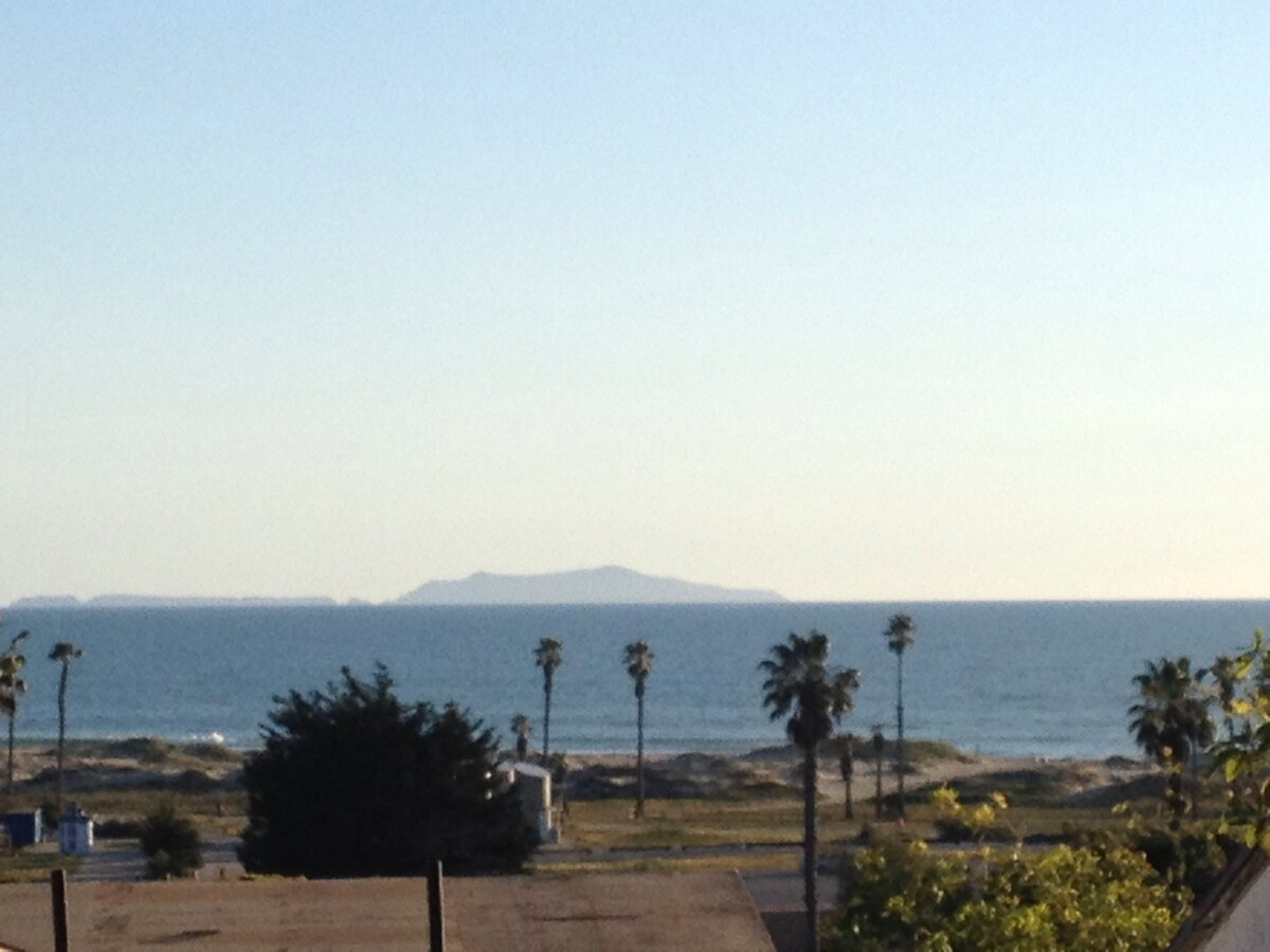 Taken from the top of the stairs. A great spot to have your morning coffee and look at the ocean and smell that ocean air! Has chairs and a pop up table.