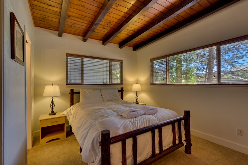 Lovely master bedroom with queen bed and unique log features (1st floor)