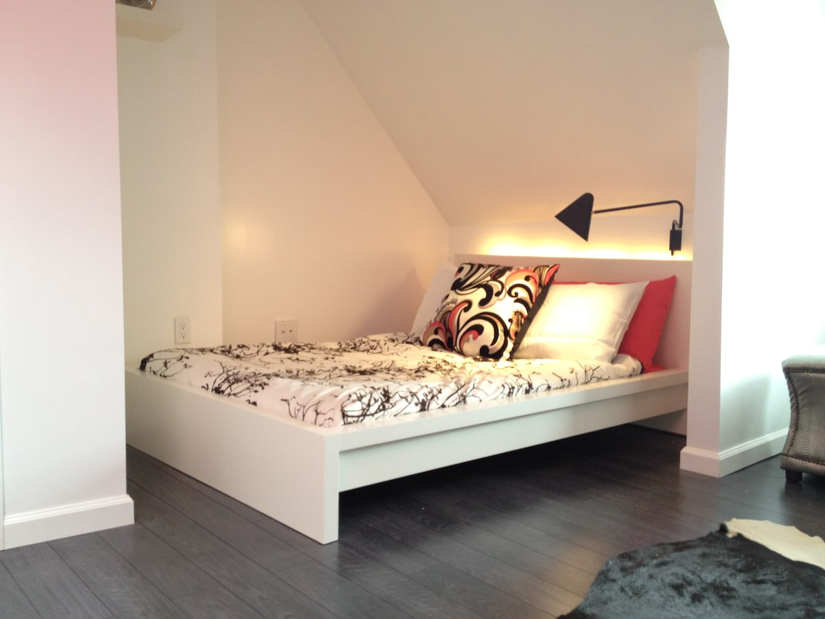 Full size bed with backlighting and reading lamp