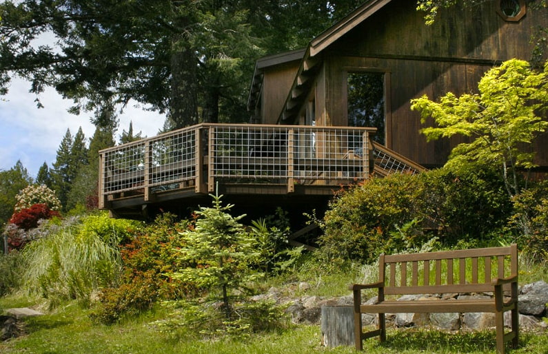 The house sits among redwoods, douglas firs, yet opens up to beautiful views and sun