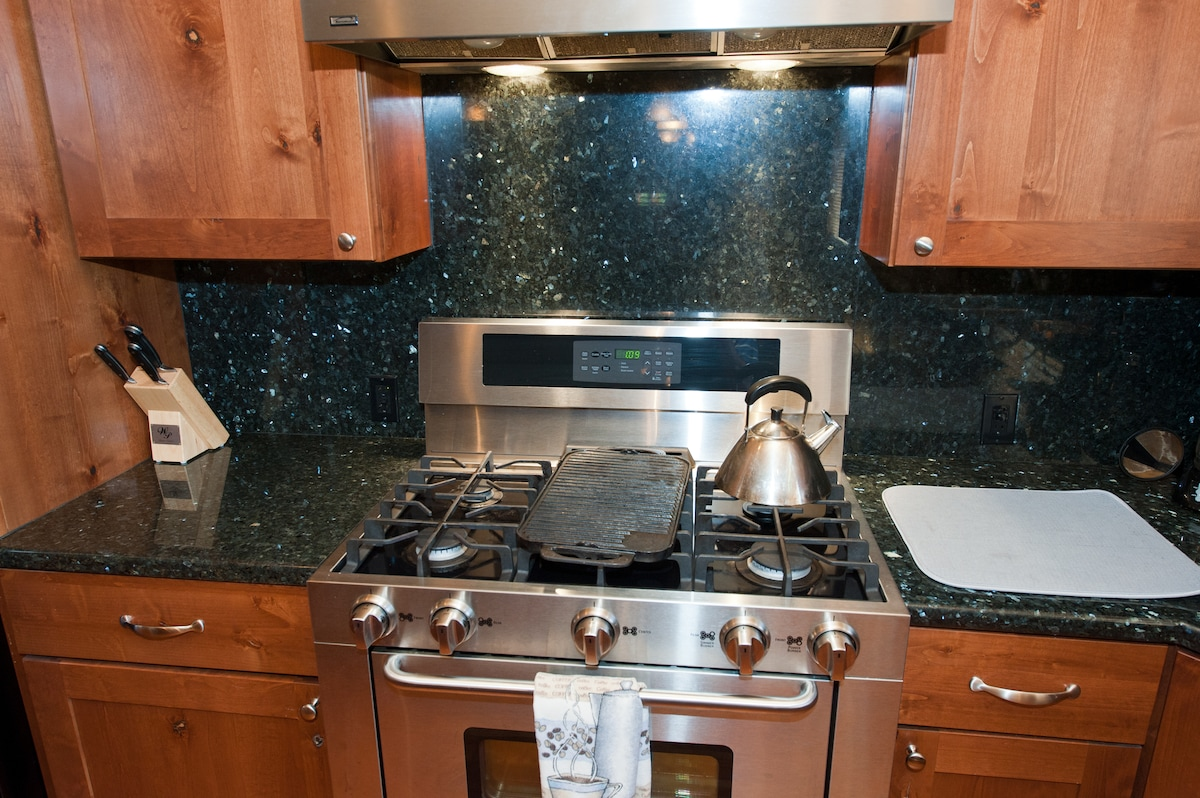 A huge 5 burner gas stove makes it easy to cook large meals