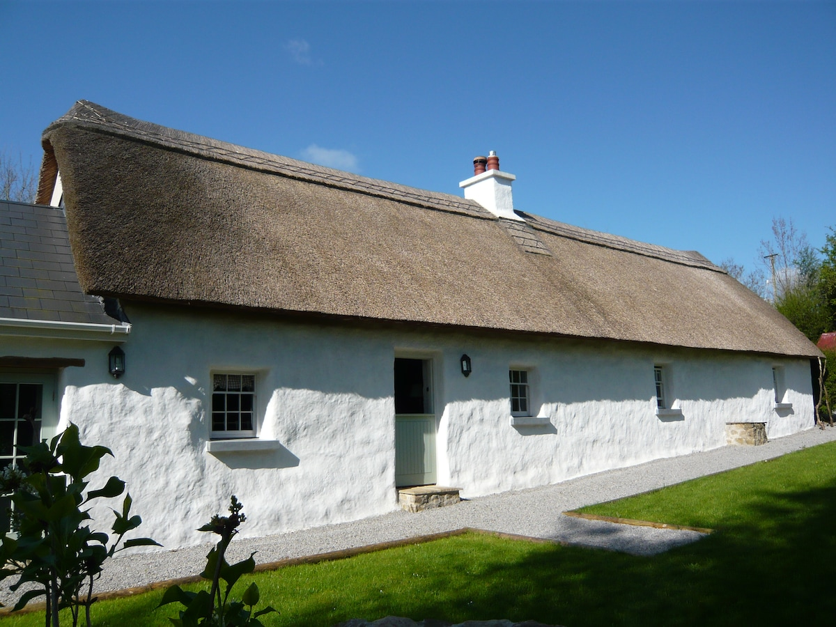 Early morning sunshine - the traditional front view of the house (not visable from the entrance gate)