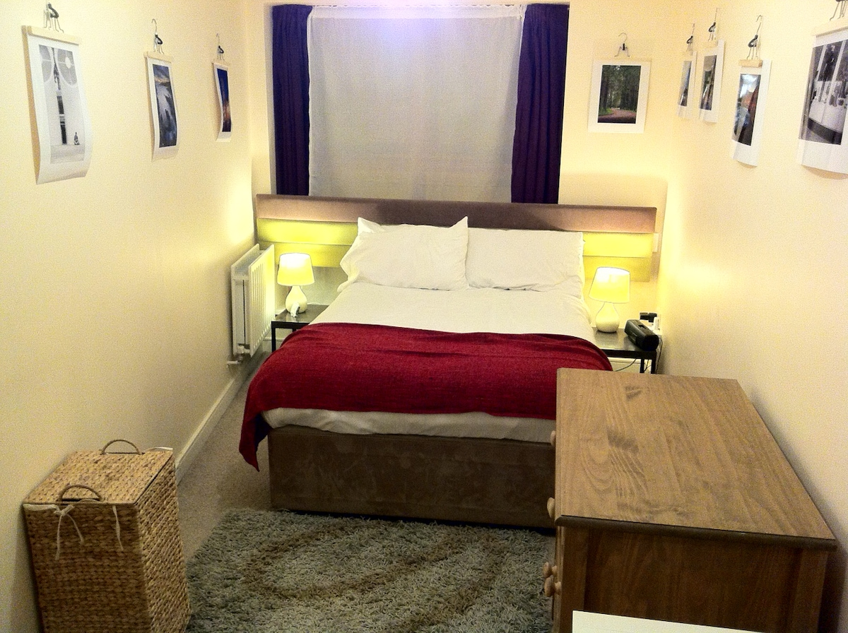 Comfortable Double Bed with iPhone/iPod radio charger and original Fine Art Photography by owner.
