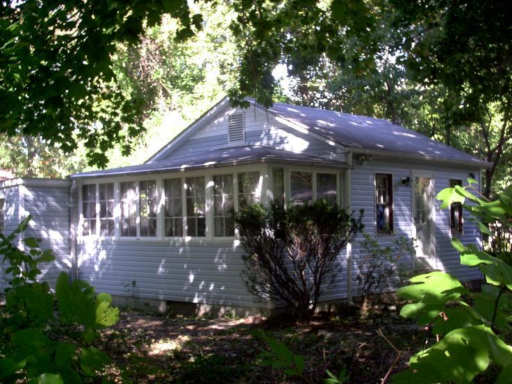 Shady Getaway/ view from south east side, showing porch/ winter garden of the house..