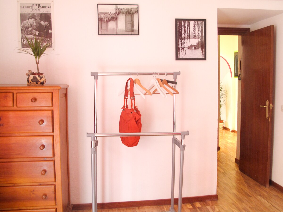 In both rooms there is plenty of space to store&hang your clothes
