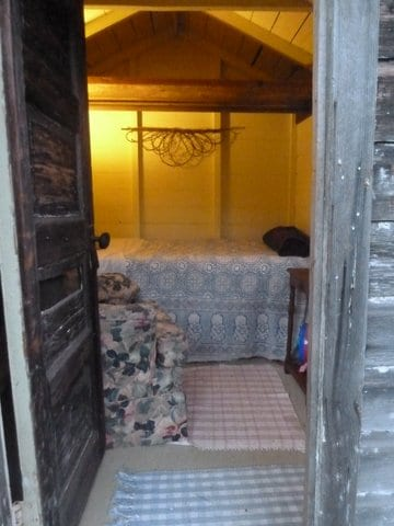 Single Bed, Bedside Table, Lamp, Chair and Dresser, Two Windows for Ventilation.