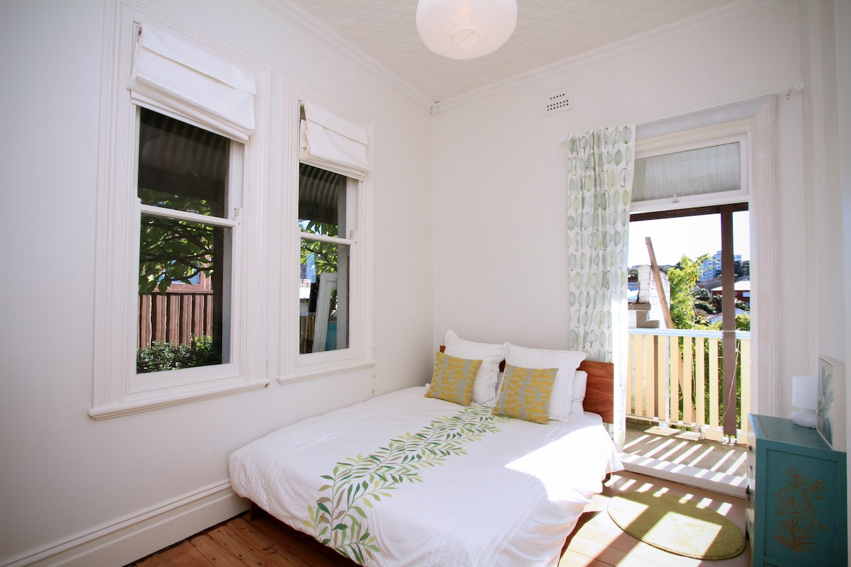 Your bedroom, north facing, opens onto a balcony and windows face garden. The room now has internal shutters on the window. The room is now configured differently, the bed is in a different spot and their is also a small desk & chair)