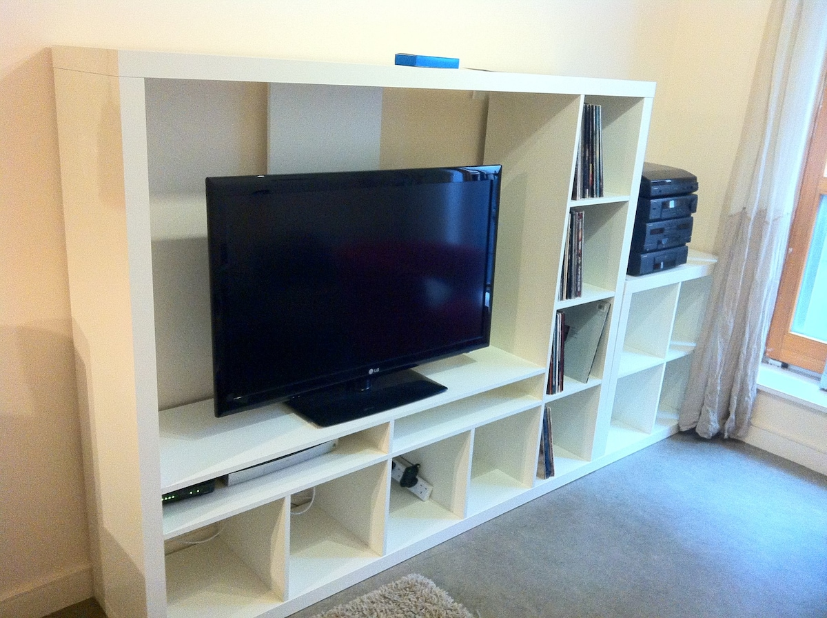 Living room with 42in LCD TV with Cable Service and sound system designed to use with iPhone/iPod