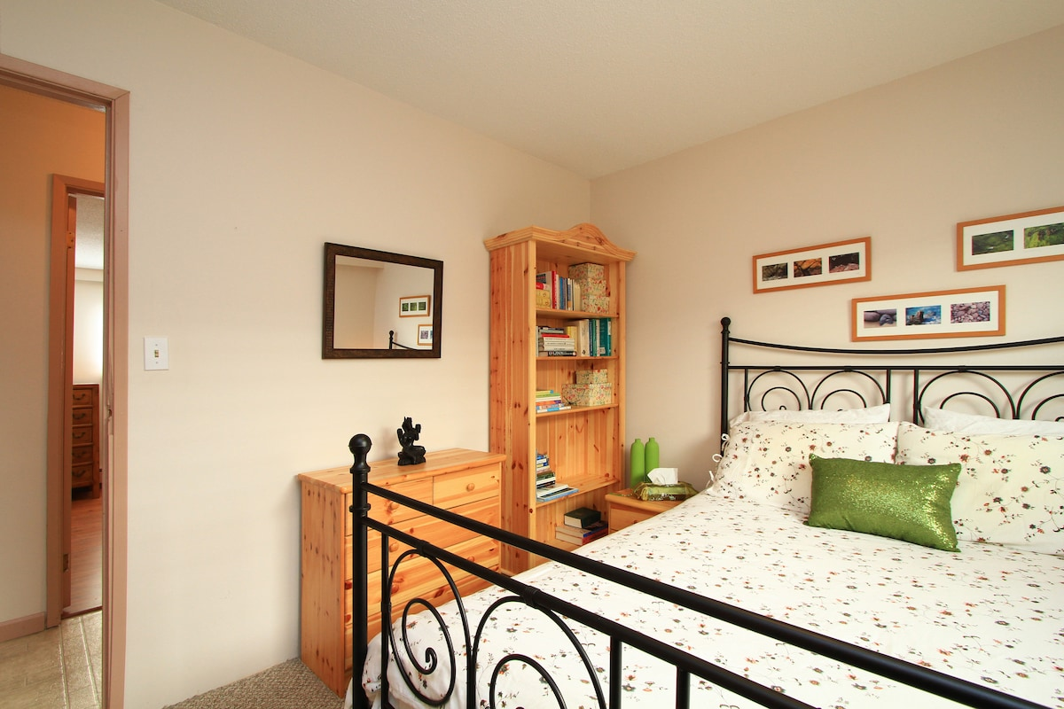 Bright and spacious bedroom with queen size comfy bed.