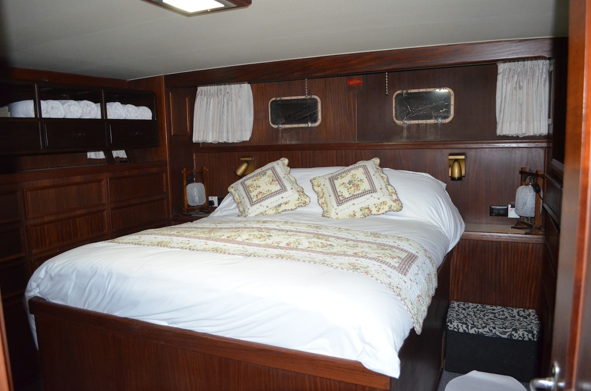 "The Master ""Captain's"" Cabin on WN is luxuriously appointed with walkaround double bed and plentiful cupboards and drawers"