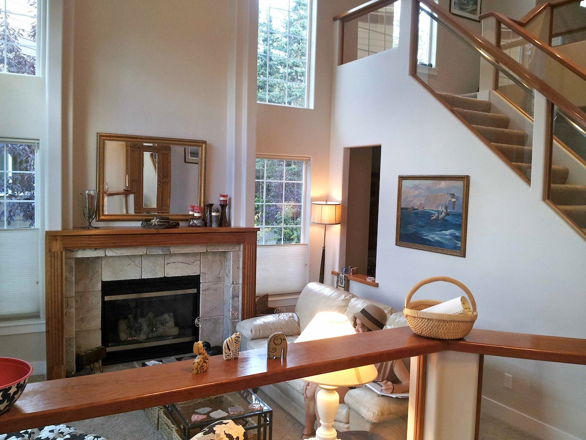 Natural light pours into the main rooms - the sunken living room just off the entry with fireplace