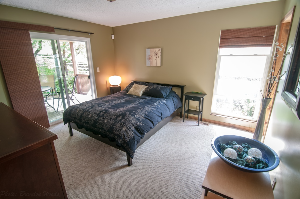 Master bedroom with view of deck.