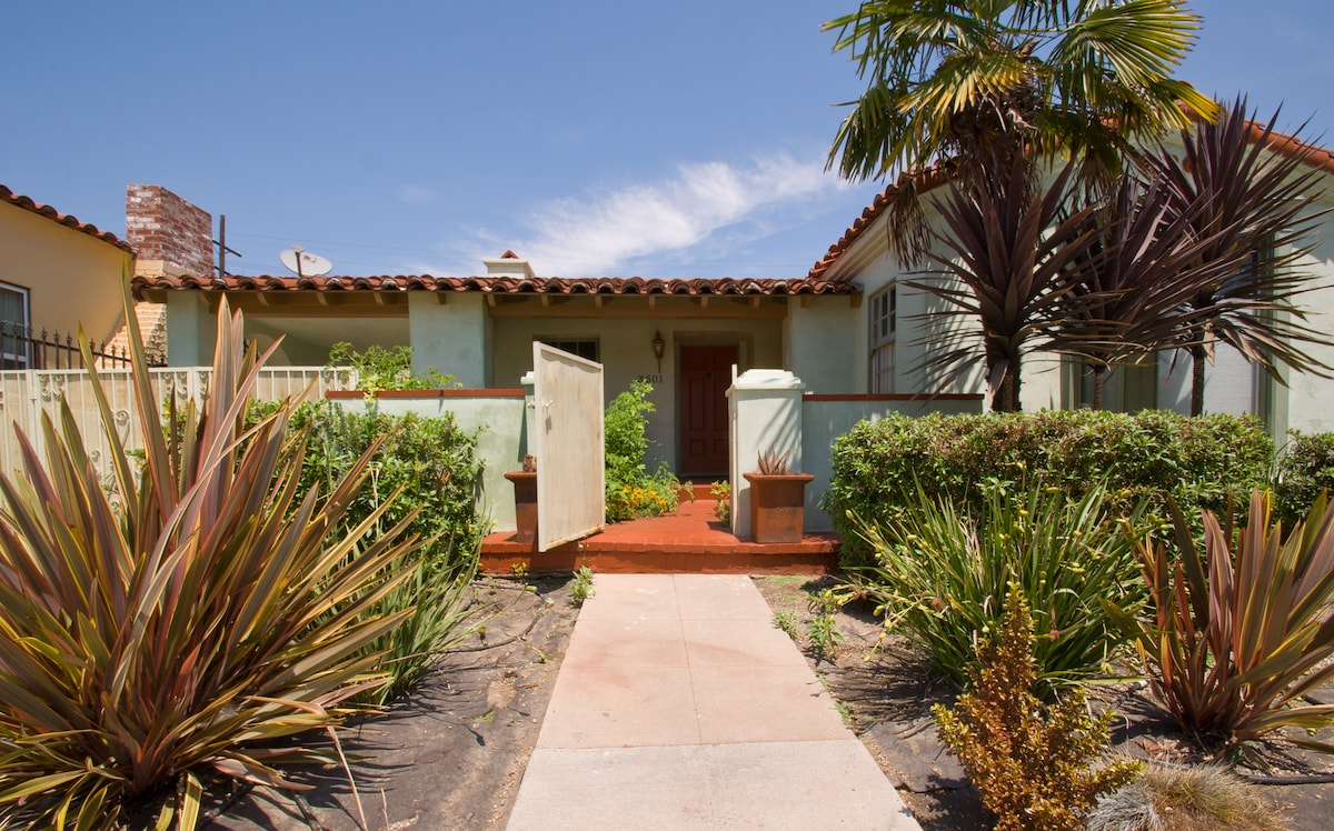 """The charming front yard leading to the """"Spanish Greens"""" bungalow, a traditional 1935 Spanish Revival, common in Los Angeles."""