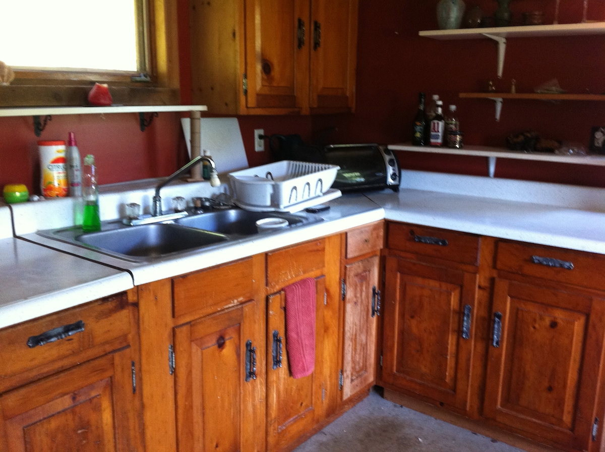 The Kitchen includes gas stove, small fridge and all the basics in appliances and cook ware