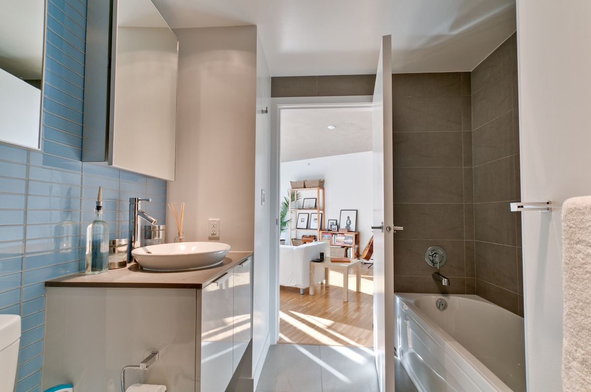 Separate Bath tub and featuring Caroma fixtures.