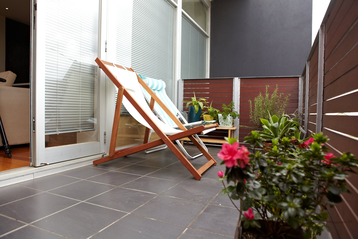 The balcony - relax on a deck chair, or use the fresh herbs to make dinner
