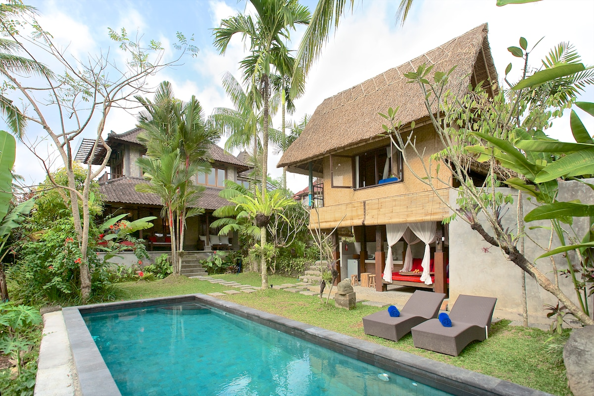 Main house in center. Balinese Lumbong on right w bedroom #3 upstairs, garden bathroom behind wall.