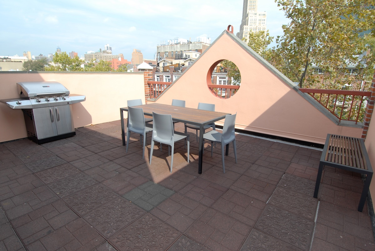 Private terrace and views of rooftops and famous Williamsburg Bank clock tower.  Sunsets!