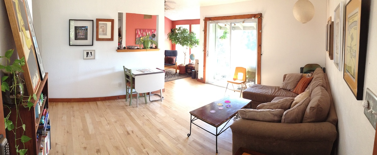 view from the front door looking back towards the front of the house and the balcony