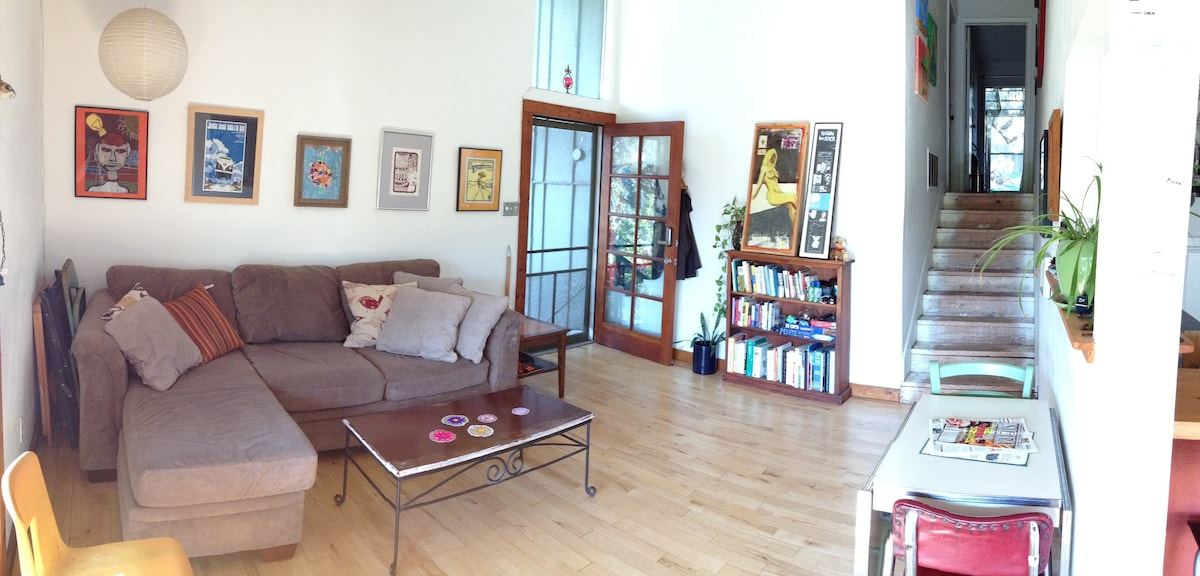 from the balcony looking towards the front door. the bedroom, bathroom, screen patio and backyard are up the stairs.