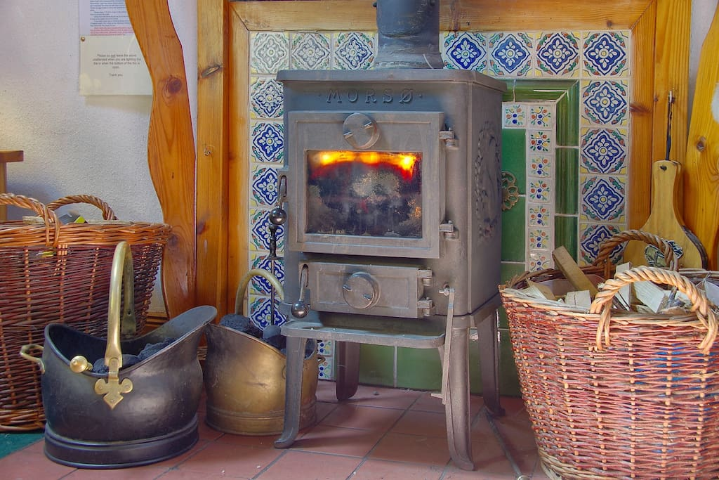 Our cosy stove with logs provided