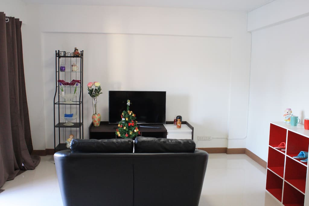 The living room with full furnish.Tv with more than 100 channels cable TV and internet access.