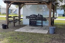 BBQ area and seating, with lights.