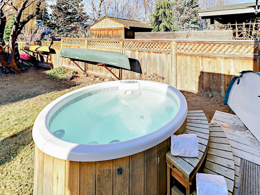Enjoy river views from the luxurious private hot tub.