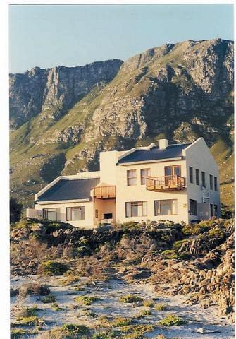 The view of the house from the ocean side, before  aluminium window frame alterations