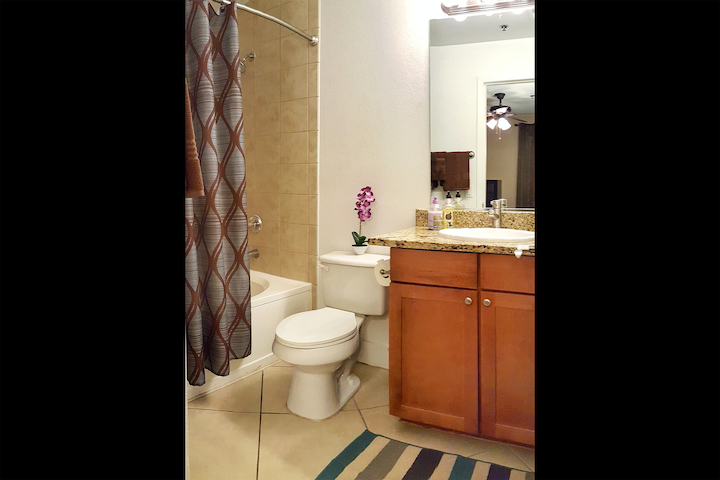 Your private, attached bathroom complete with granite counters and tile flooring