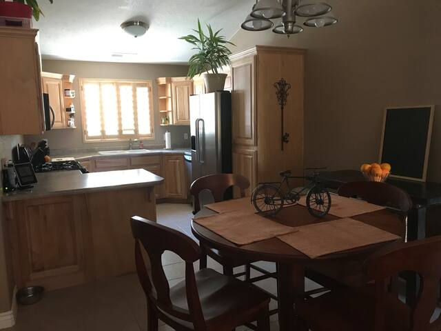This is the kitchen and dining area. Cupboard and fridge space is available. Reusable grocery bags and travel mugs are here as well. It's a small effort but one of worth.