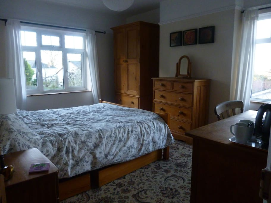 Large airy double room with windows facing south and west.