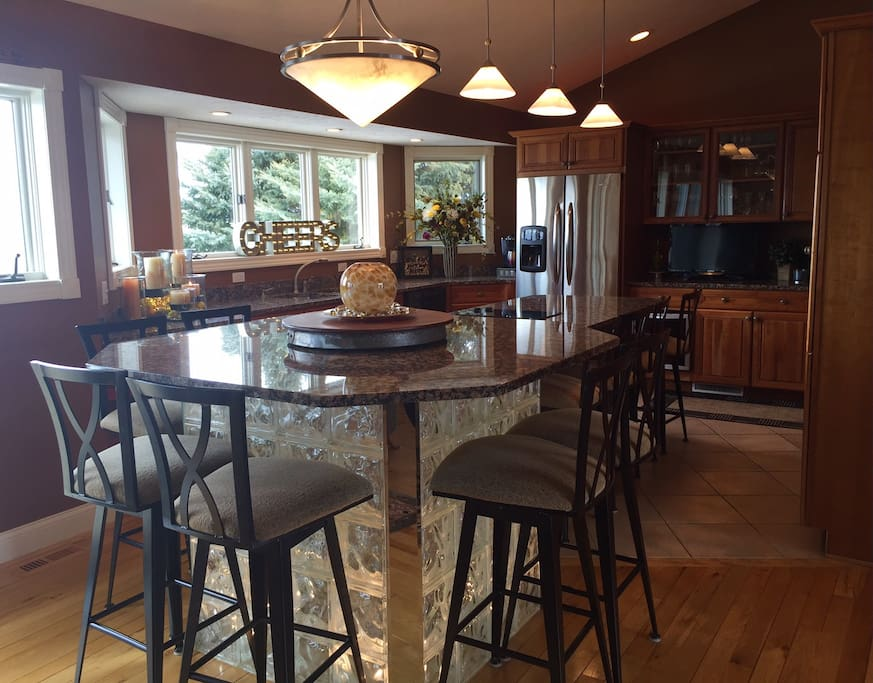 Chef's kitchen with plenty of space for guests to enjoy the view and socialize