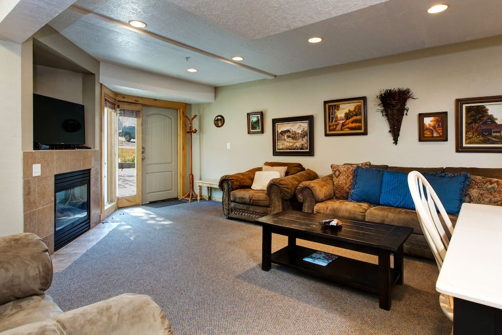 With mountain getaway essentials like a comfy couch, a flatscreen TV, and a gas fireplace!