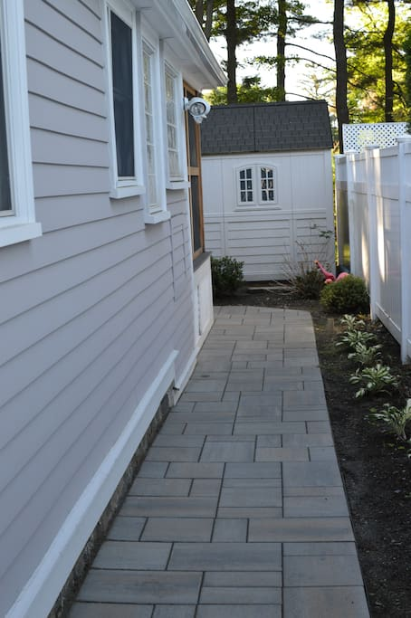 Walkway along side of house, to back patio and rear door (where you'll travel to enter the house)