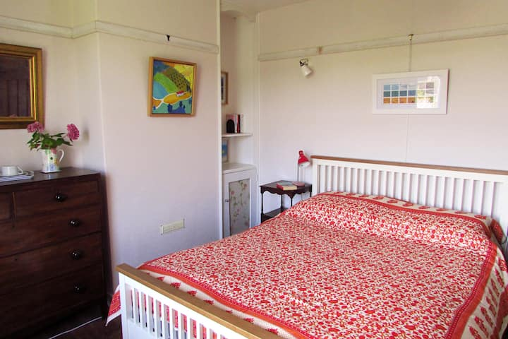 Peaceful airy room in popular village location