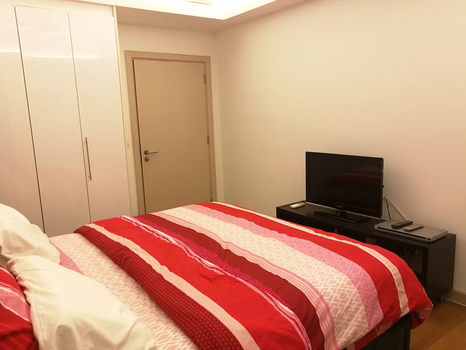 Different angle of bedroom with air-cond, fan, TV & DVD player
