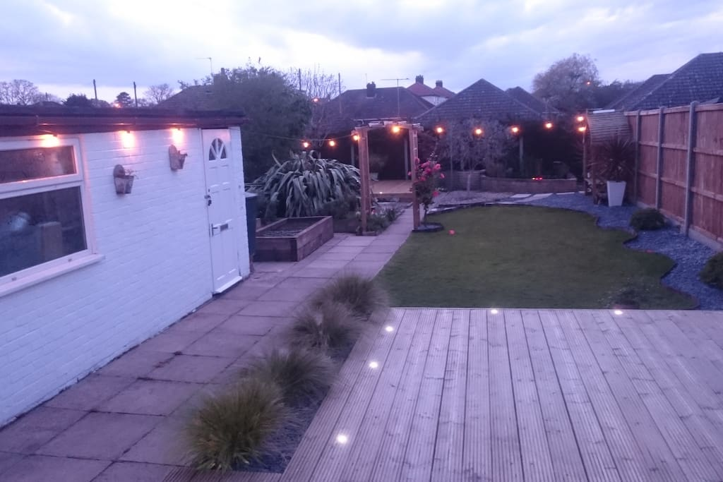 View on the beautiful and secluded back garden from the conservatory at dusk