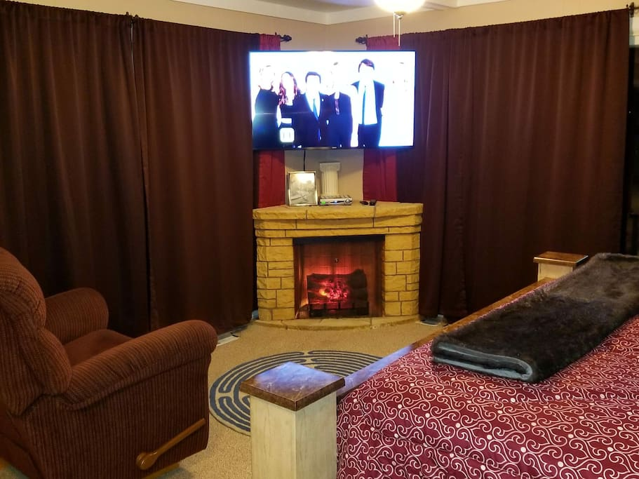 """55"""" Samsung 4K with Cable & electric fireplace."""