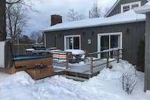 Located off of the back deck is a six person seasonal hot tub available fall, winter and spring only.